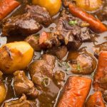 Close up of chunky vegetables in lamb stew.