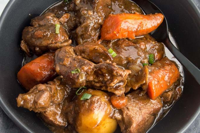 This Irish Lamb Stew recipe is made by slow cooking the lamb in a deep rich velvety broth. Mixed with rustic chunks of carrots and whole potatoes make this one pot meal a complete comfort food!