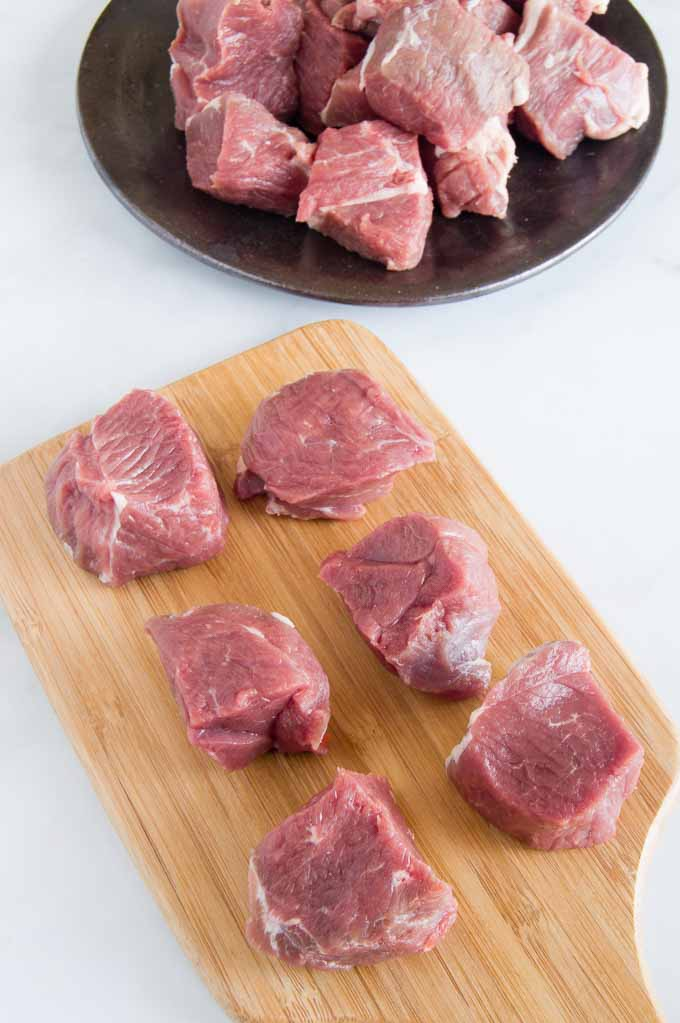 Large pieces of lamb cut for rustic lamb stew