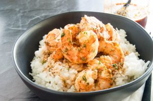 Spicy Smoke Sauced shrimp served warm over rice