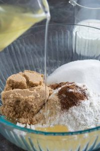 Mixing the sugars, flours, spices with the oil for Coffee Cake