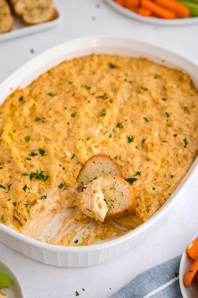 hot crab dip in a white baking dish
