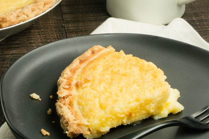 An Easy Buttermilk Pie recipe (in a pre-made crust if you want) that yields a sweet pudding like custard center like a chess pie with a crunchy top like creme brûlée in every bite!