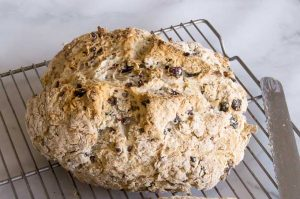 Traditional Irish Soda Bread can be mixed up in five minutes with 4 simple ingredients, flour, soda, buttermilk and salt. Baked to a tender crumb inside with slightly crunchy edge shell. Easily personalized with your favorite ingredients (nuts, fruits, chocolate)