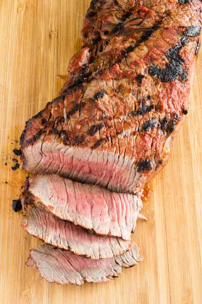 Showing an example of cutting across the grain on a flank steak for the most tender steak