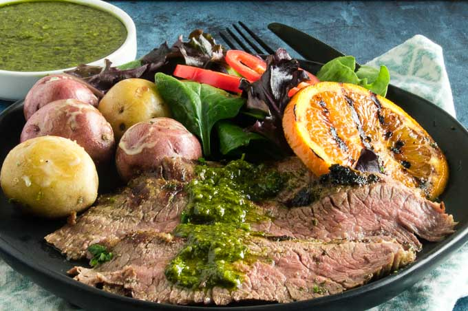 Grilled Chimichurri Steak, an authentic Argentinian recipe which uses a 5 minute simple sauce-marinade from made of fresh herbs, garlic, lemon juice and olive oil.  Marinate for concentrated flavor or brush on as its grilling!