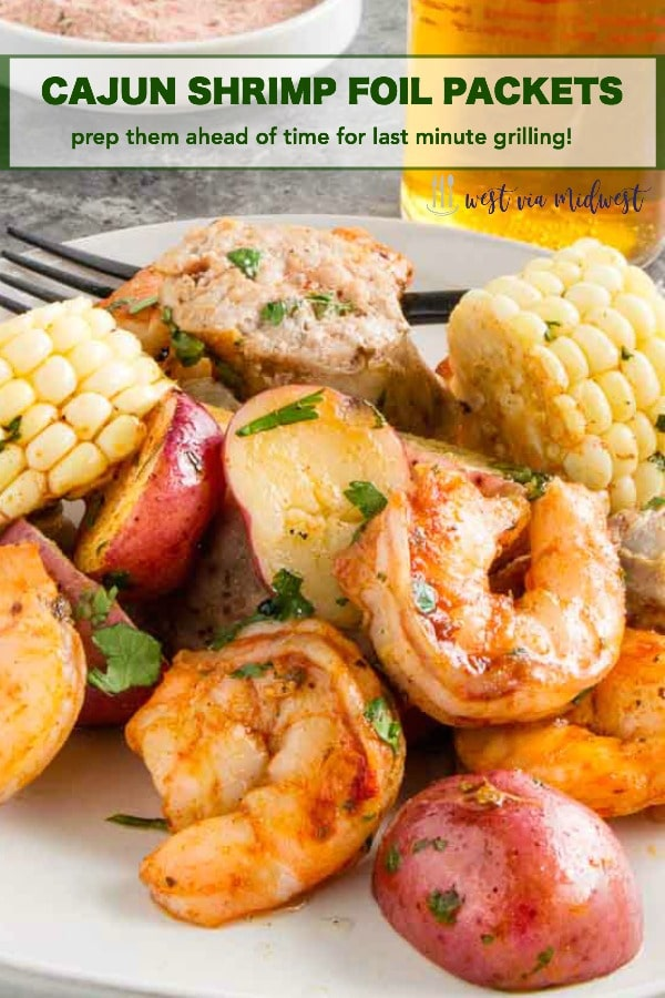 Shrimp Boil on A plate This Cajun Grilled Shrimp Foil Packet can be made ahead ready to grill when you're ready to eat.  Easily customizable, full of delicious cajun/creole flavors. #shrimp #grilling #healthygrilling #cajun #shrimpboil #shrimpcreole