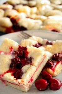 cherry bars on a plate in the kitchen