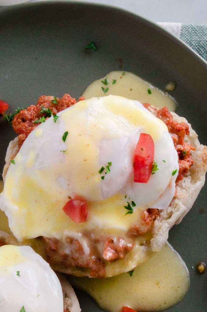 Close up of poached egg in Italian eggs Benedict