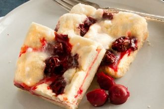 Cherry Pie Bars are easy to make and serve for dessert for Summer BBQ's!  Tart Cherries give a burst of flavor over the tender crumb bar in every bite!