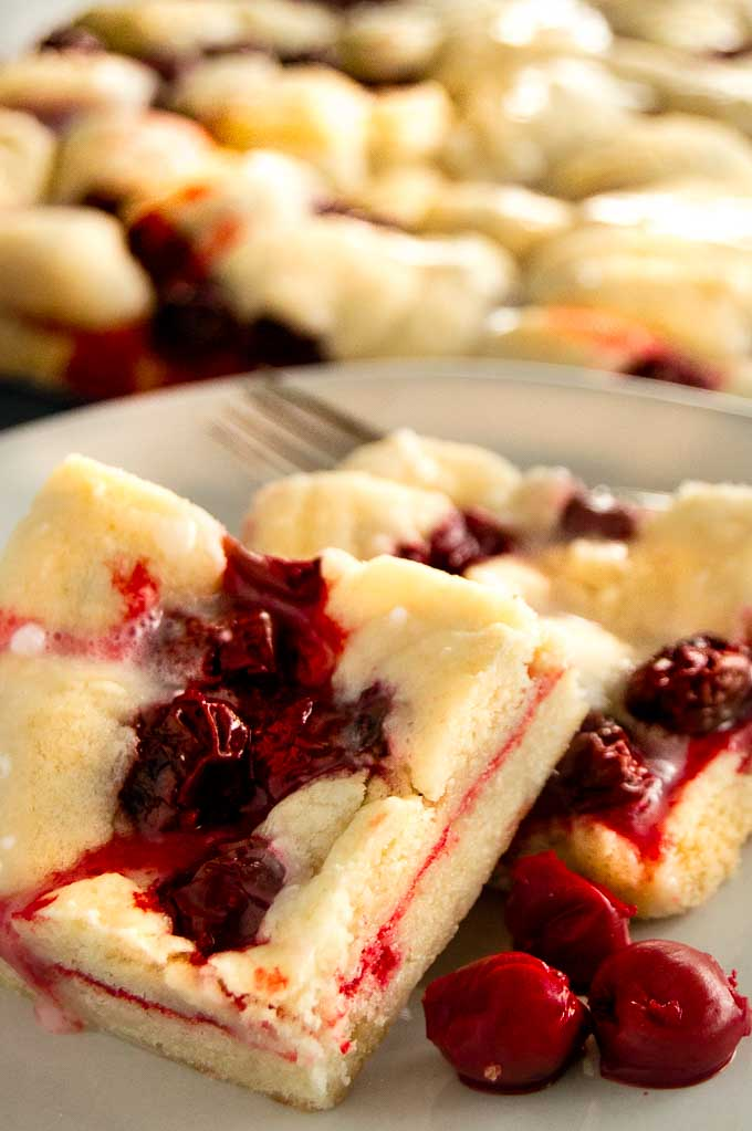 Cherry Kuchen Bars on a plate for eating