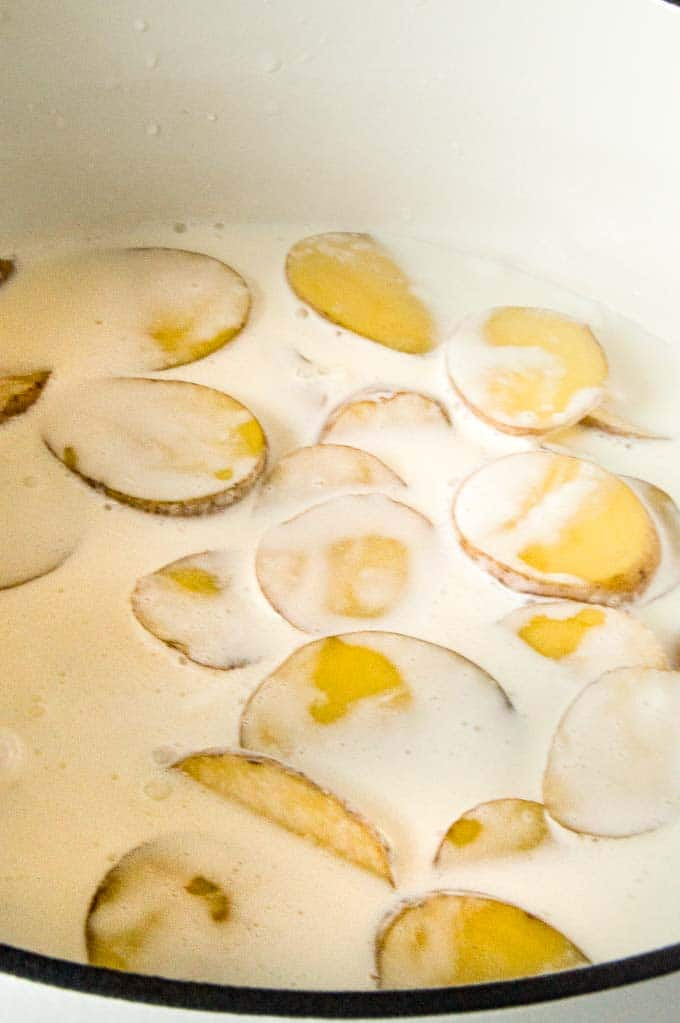 Slice Potatoes boiling for scalloped potatoes