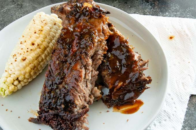 This Oven Baked Beef Ribs recipe is so easy. Dry rubbed with delicious seasoning, low temp bake yield fall off the bone tender, juicy meaty ribs that will be the hit of any BBQ party all in less than 15 minutes of work!