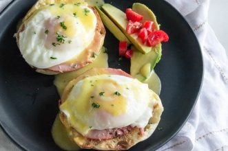 Classic Eggs Benedict has the perfect mix of egg, ham and toast all wrapped in a creamy hollandaise sauce.  An easy, gourmet breakfast for everyday and special occasions!