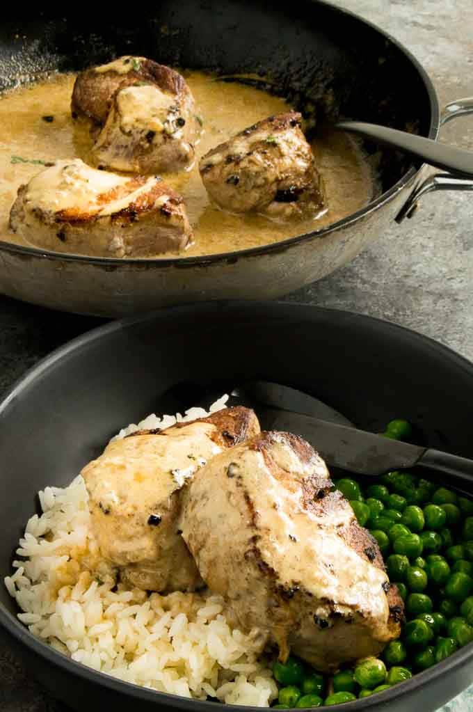 Tender Pork medallions with blue cheese sauce spooned over! One pan meal
