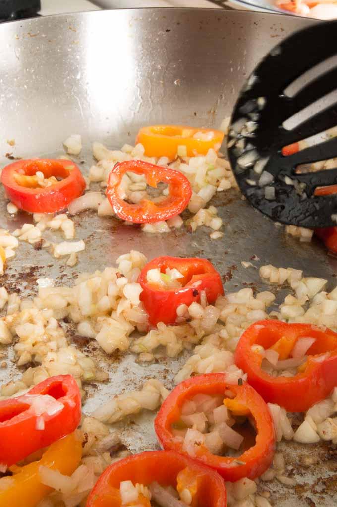 Adding onions and garlic for shrimp Alfredo.