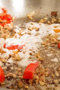 Adding a dab of flour for shrimp Alfredo