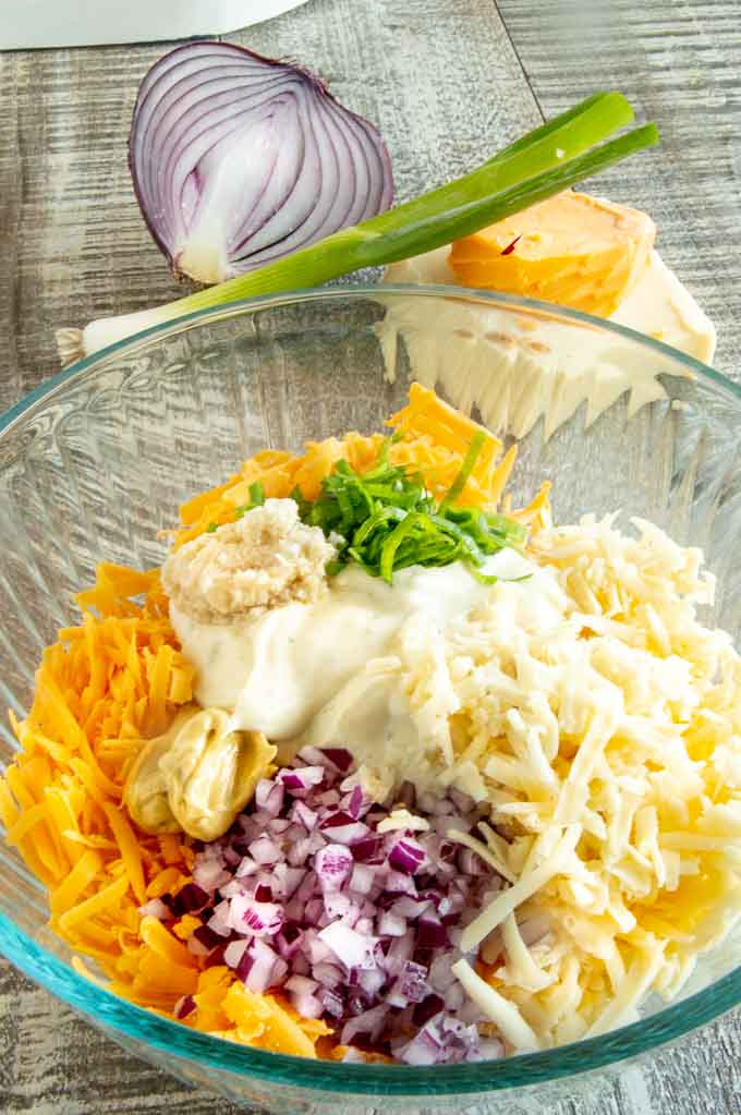 Cheese, onions, mustard, horseradish, mayo and onions make up 5 minute crack dip