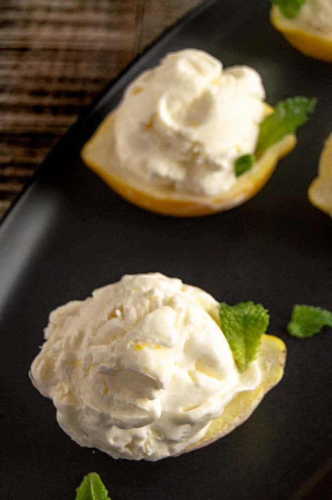 Individual Lemon shells holding fresh no churn lemon ice cream