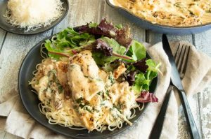 Creamy Tuscan Garlic Chicken is the easiest gourmet meal to make ever!  One-pan stove top chicken that is tender and juicy in a creamy tangy garlic parmesan sauce with sun-dried tomatoes and spinach.
