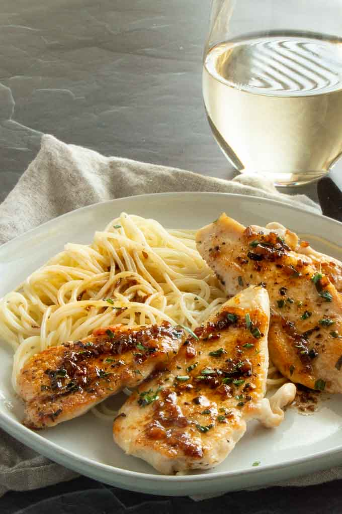 Dinner plate of Tarragon Butter Chicken breasts and pasta