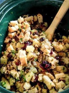 slow cooker base full of cranberry crockpot stuffing