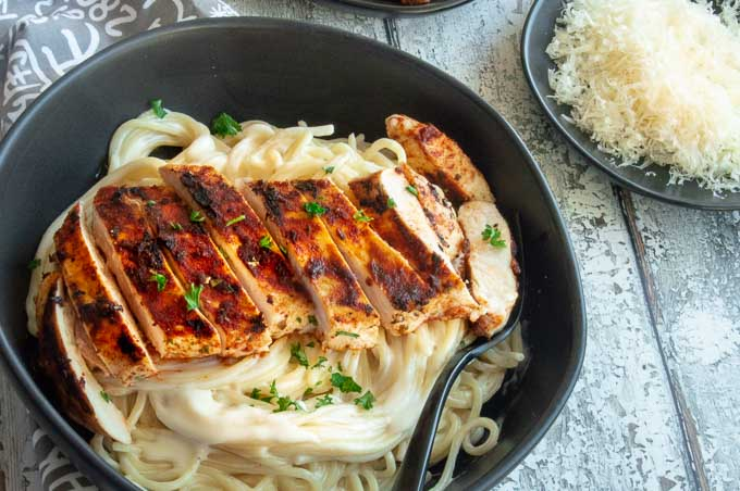 Cajun chicken over creamy Alfredo pasta