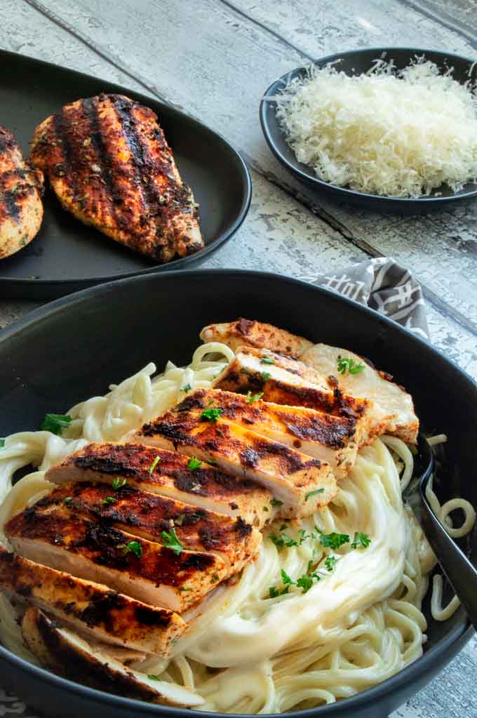Sliced Cajun grilled chicken on a plate