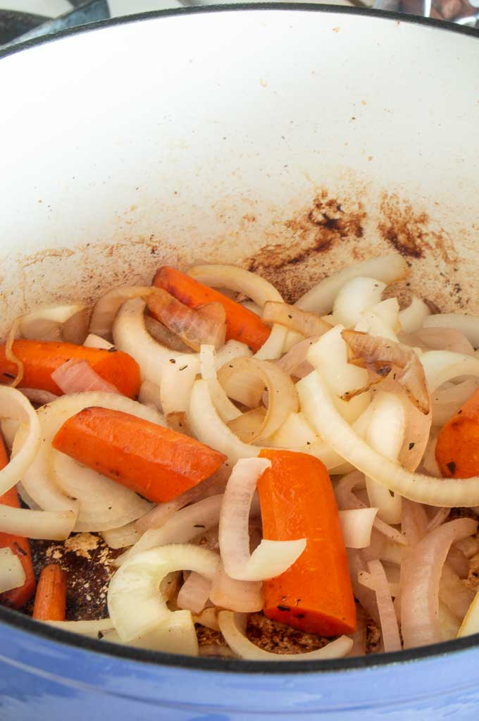 Caramelizing the onions and carrots before placing them into the pot for slow cooking