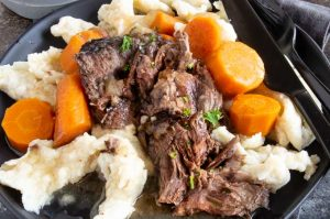 German Pot Roast/ Sauerbraten recipe is a traditional German pot roast made in the slow cooker. It's so tender it just pulls apart. Marinated in vinegar, wine and simple spices it's perfect for your own authentic Oktoberfest party!