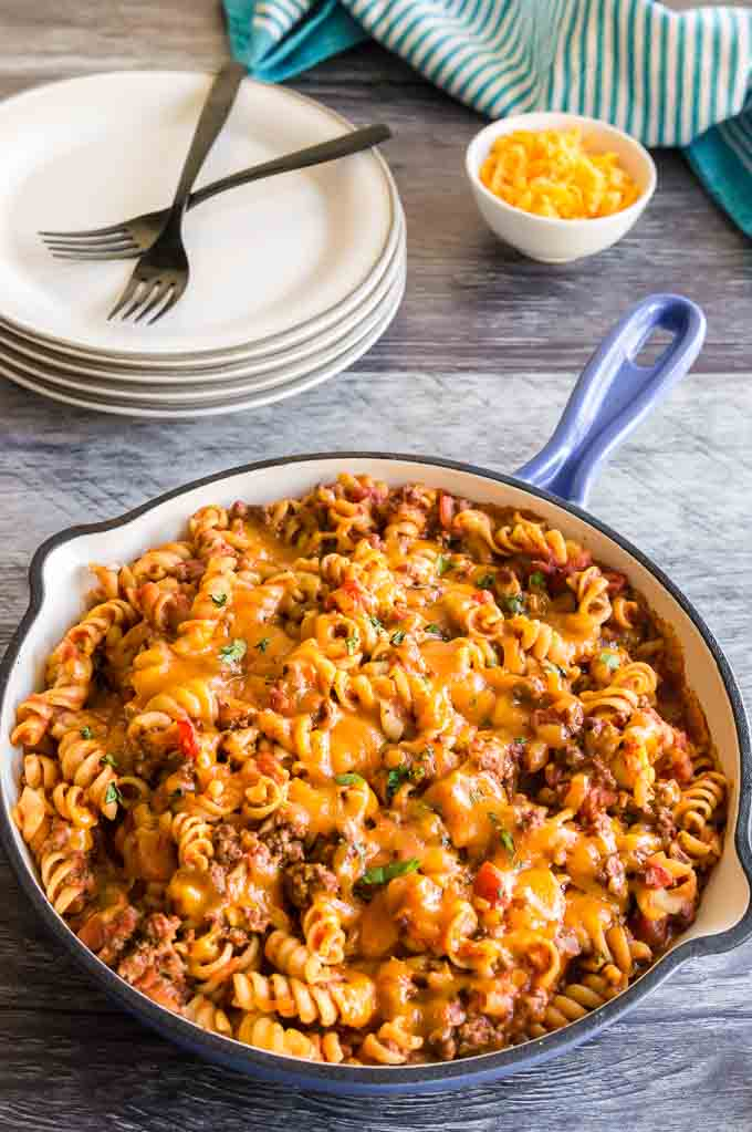Pan full of cheesy Mexican pasta on table