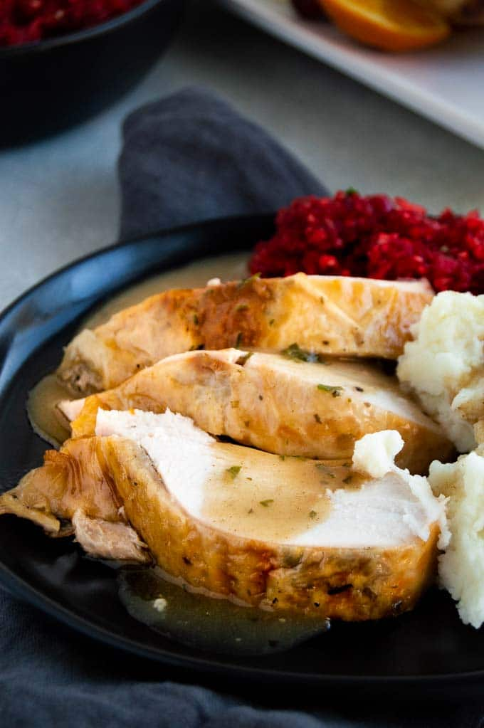 thick slices of turkey with gravy on a plate