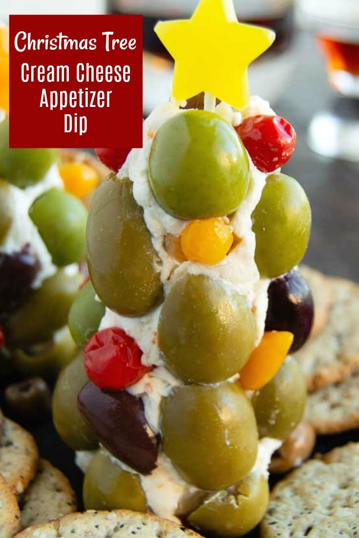 A simple last minute dip for Christmas!  Made with ingredients you have on hand, cream cheese, olives and cheese in a festive shape you can put together in about 15 minutes. Christmas potlucks, Christmas cocktail parties or just for family dips!