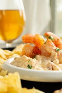 Party tray with beer and shrimp dip for guests
