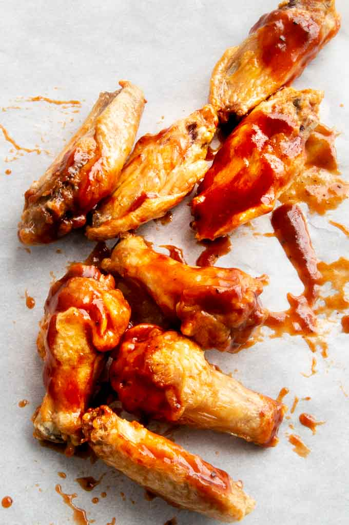 Tossing Airfryer wings onto parchment paper