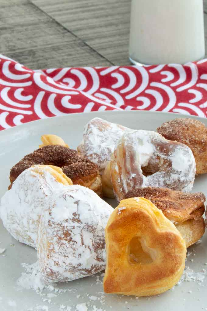 White plate with heart shaped air fried donuts