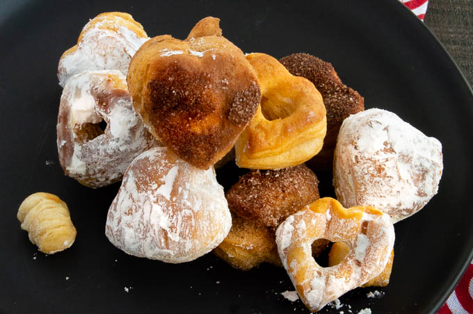 Heart shaped Airfryer donuts come together in less than 10 minutes and are perfect for Valentine's Day!  Made with store-bought biscuit dough so no mixing at all!