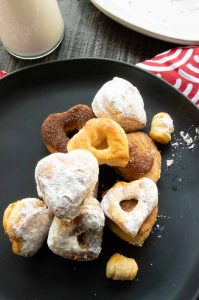 milk and donuts for valentines day in a heart shape