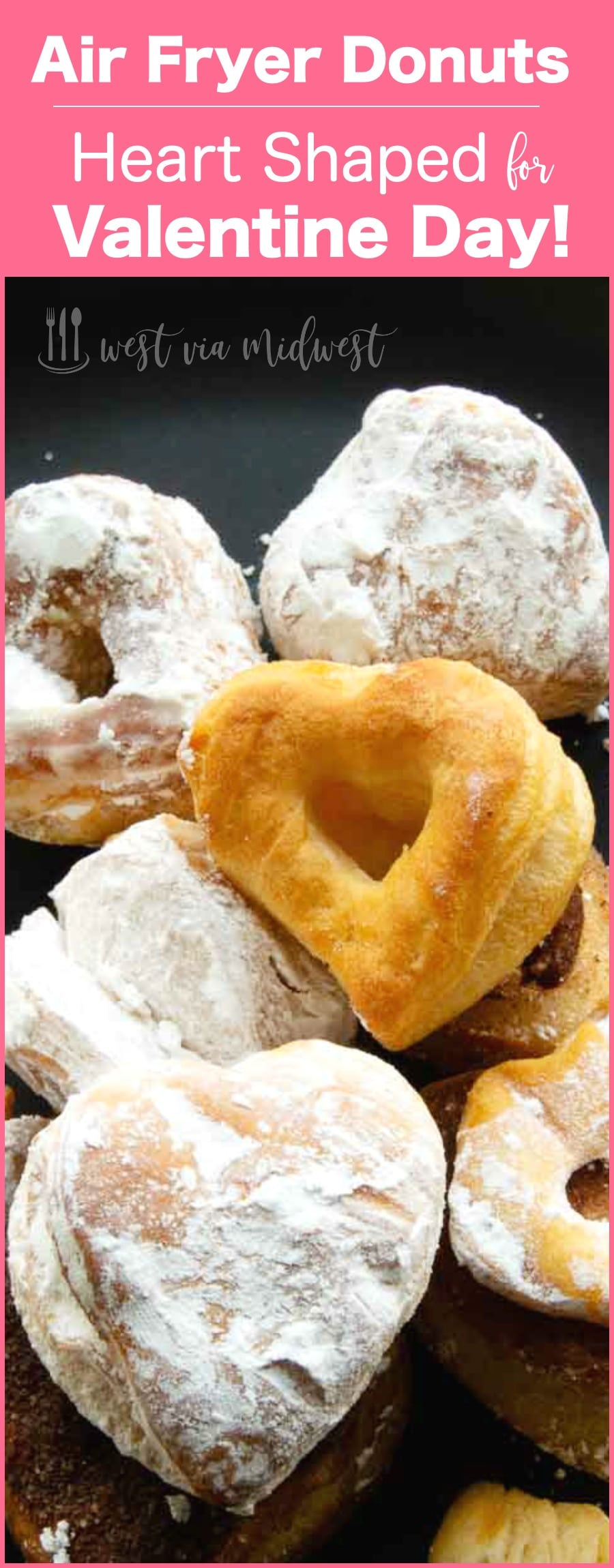 powdered sugar donut hearts on a tray