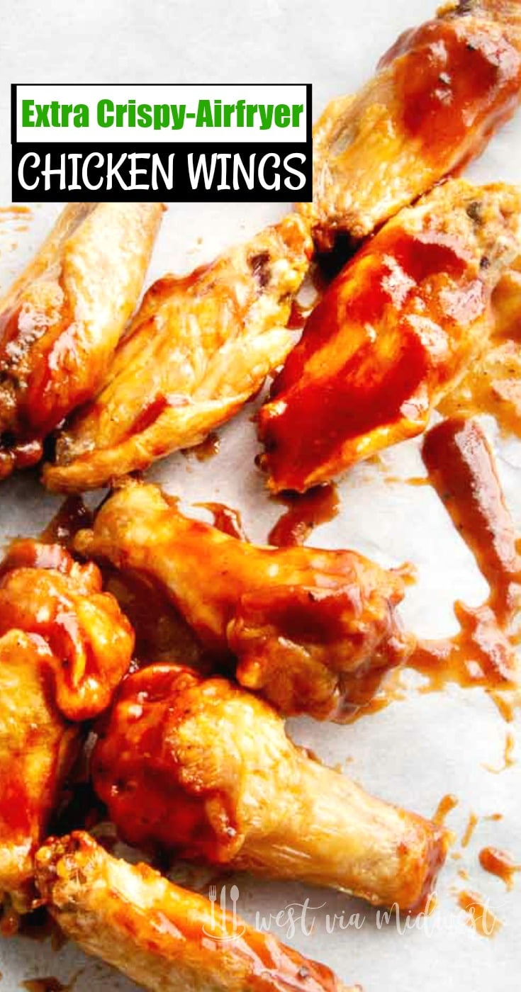 Dousing AIrfried Chicken wing game snacks in BBQ sauce