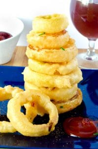 tower onion rings next to a cocktail