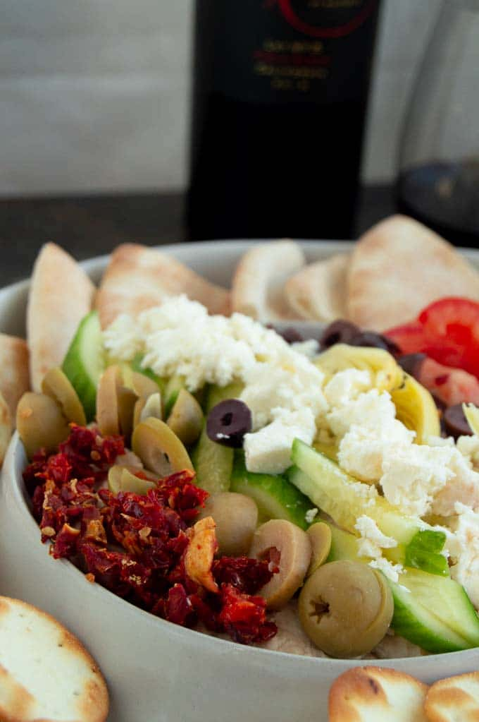 close up of the layers of Mediterranean dip