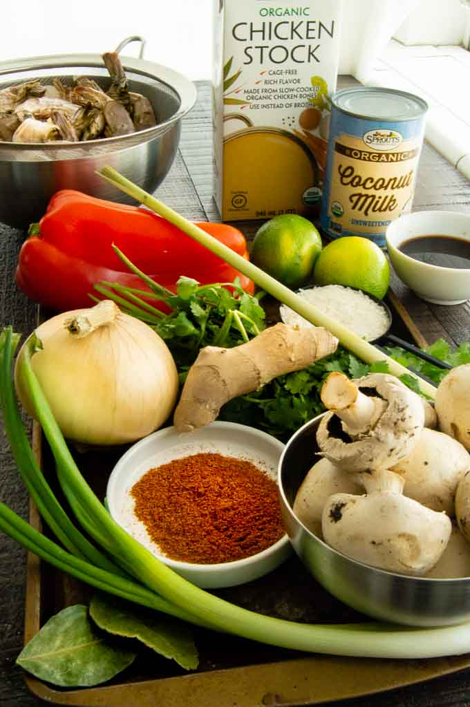 all the ingredients on a tray for shrimp soup in a thai broth