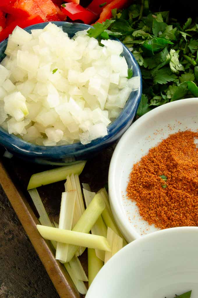 minced onions, red curry powder and lemon grass for thai soup