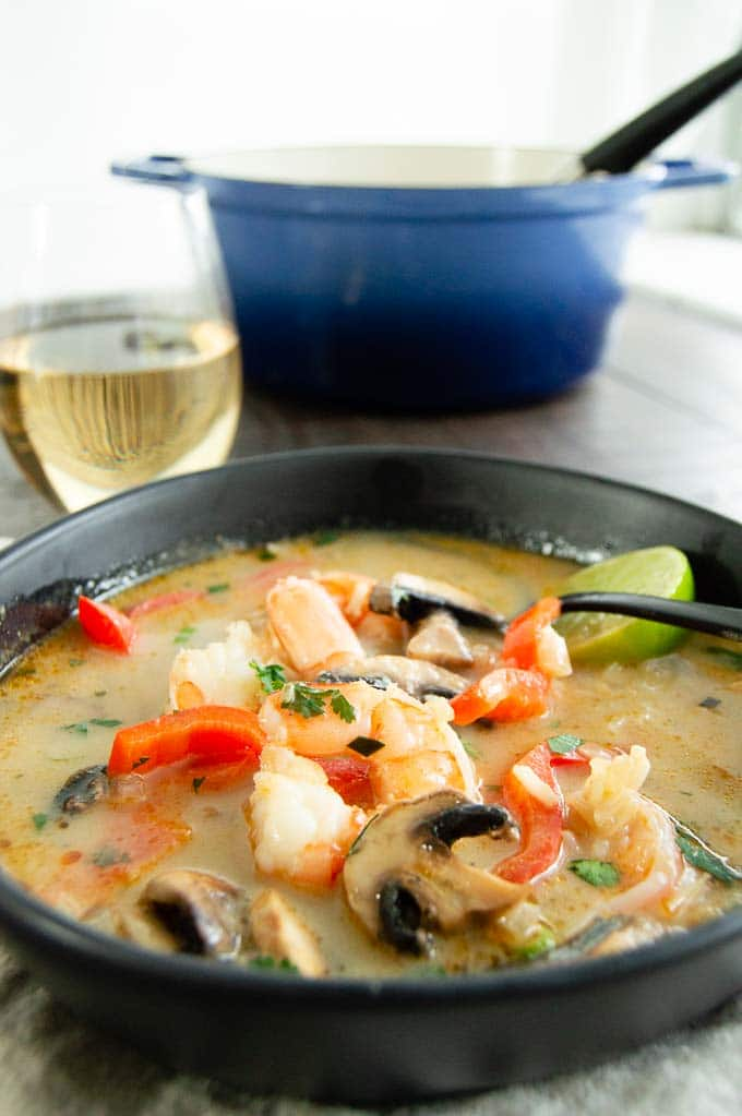 Buffet table of pot of thai curry shrimp soup