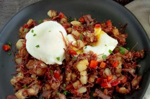 Perfect poached eggs on top of cooked hash