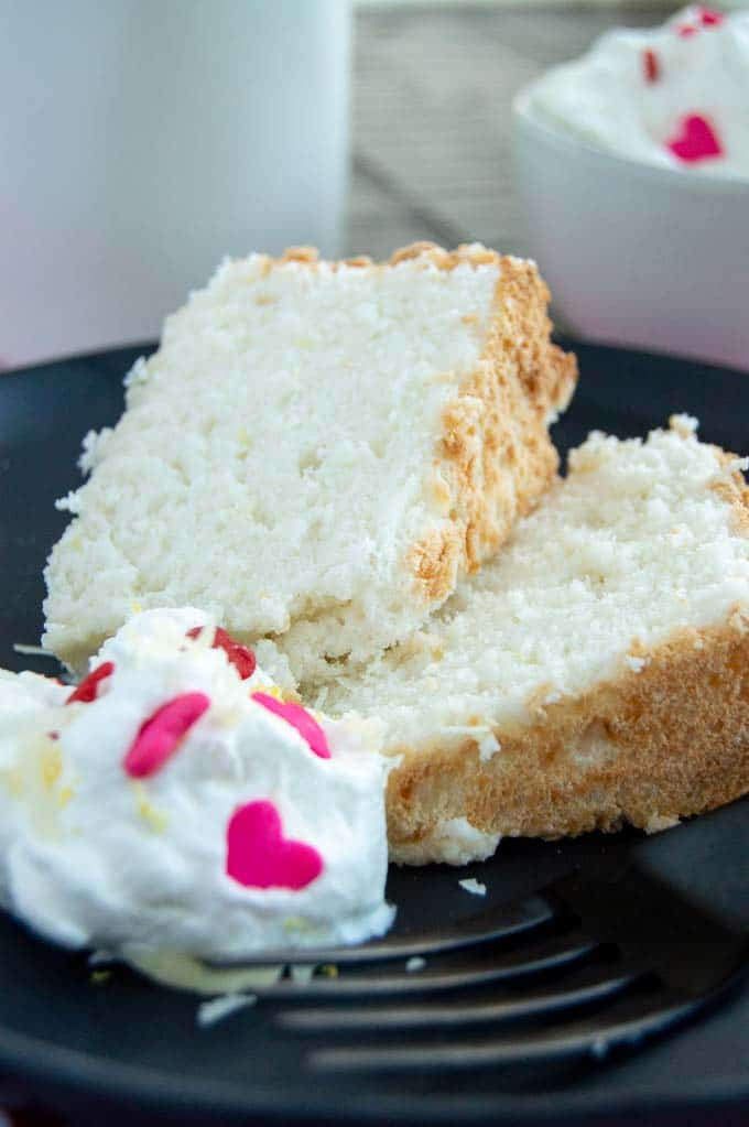 Light and airy coconut cake dressed up for valentines day with heart candies