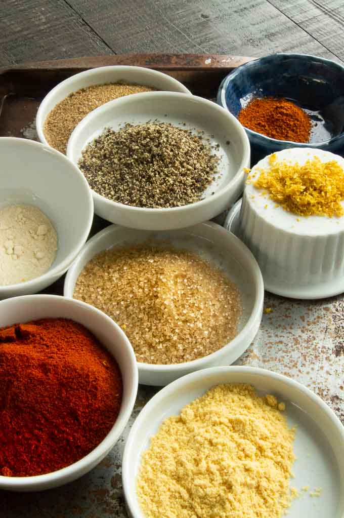 Ingredient up close for pork seasoning: Raw sugar, lemon zest, paprika, dry mustard, onion powder, cayenne pepper