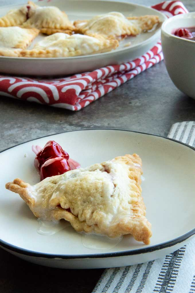 cherry hand pie on a plate