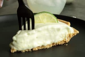 taking a bite of lime frozen pie